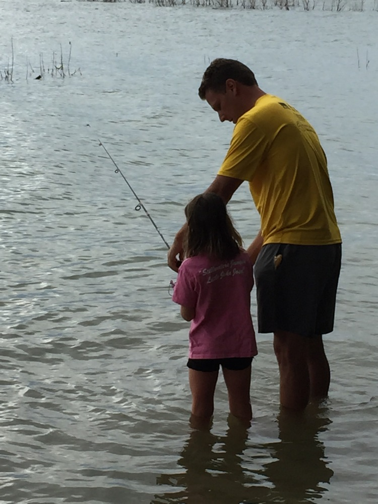 Leah fishing for the first time with tony.  July 2015.  I love, Love, Love this picture!